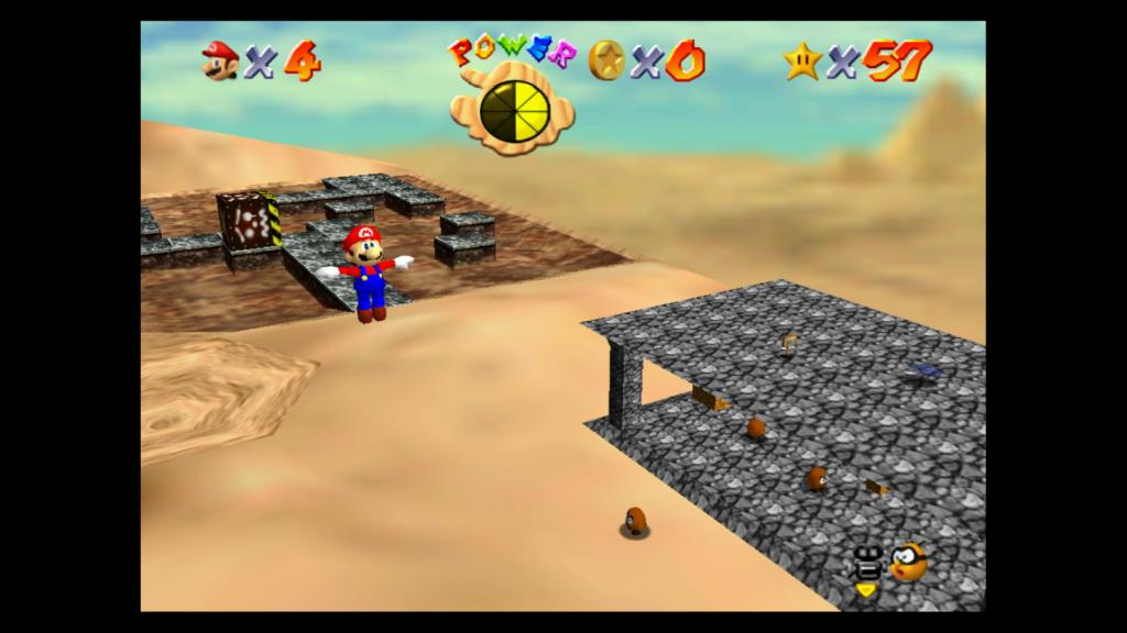 Os visuais de Super Mario 64 combinam melhor com o modo portátil e as texturas mais simples (como a areia) são as que envelheceram melhor. (Imagem: Reprodução)